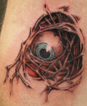 skin rip eyeball tattoo