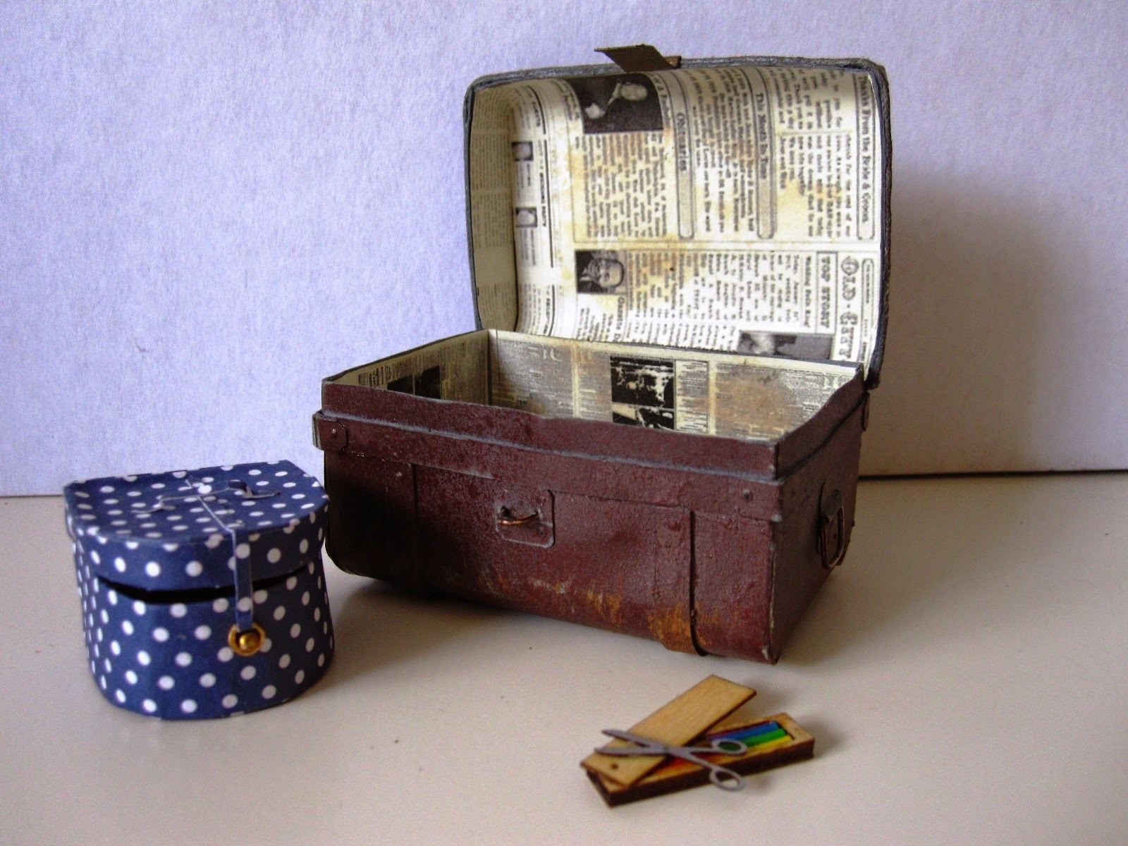 Miniature blue and white polka dot hat box, vintage tin trunk and crayon box with scissors.
