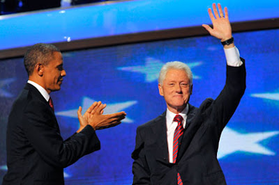 President Obama applauds Bill Clinton after his speech at the Democratic National Convention on Wednesday night