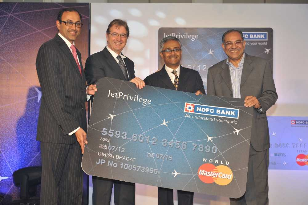 Jet airways partners with hdfc bank to launch an exclusive range of mastercard nikos kardassis ceo jet airways paresh sukthankar ed hdfc bank handing over the first jetprivilege hdfc bank co branded credit card to reheart Images