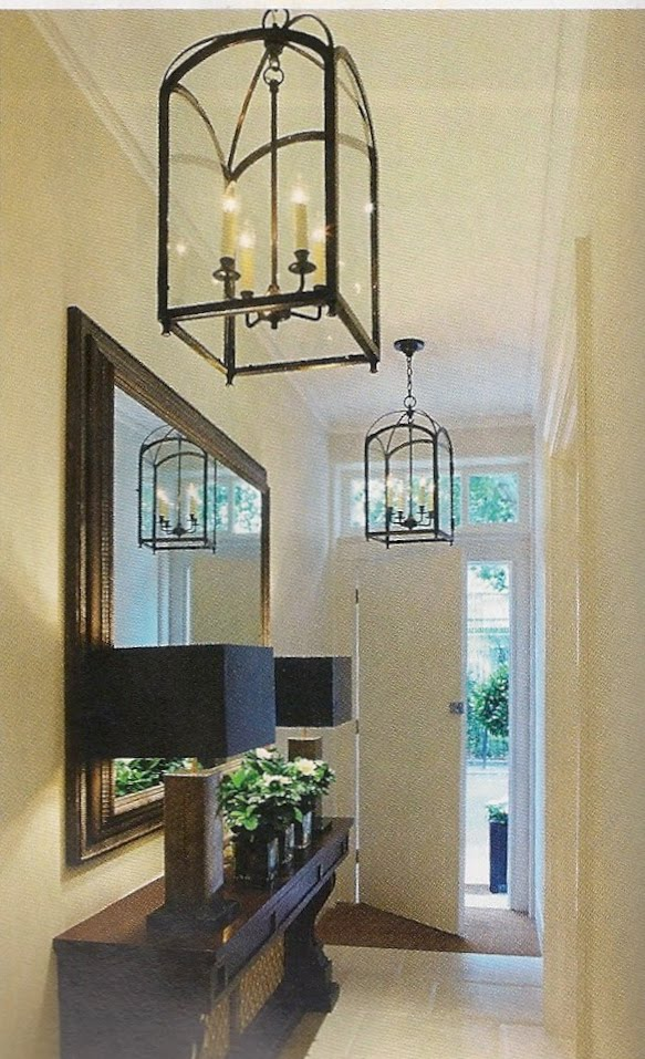Featuring the hanging tapering genghis lantern in patinated bronze which hangs on the upper landing of charles country house