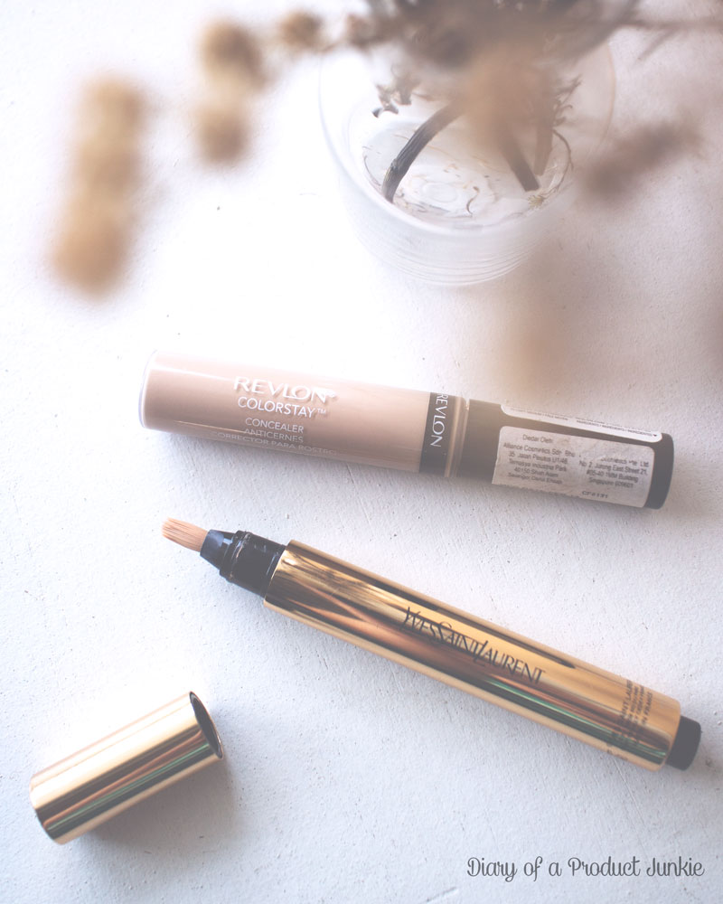 revlon concealer and touche eclat highlighter on a white wooden surface