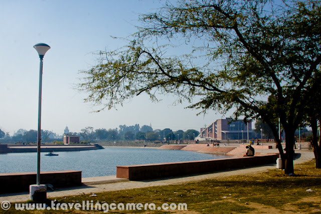 City Beautiful Chandigarh has got another Lake apart from the famous Sukhna Lake. It's situated in very peaceful region of Sector 42. Let's have a quick Photo Journey of Lake - 42 in City Beautiful of Punjab...Hope you have already visited the Sukhna Lake, if not let's have a quick Photo Journey HERE. Although the new lake at Sector-42 can't be compared to Sukhna Lake, but this is again a beautiful gift to residents of Chandigarh, especially for folks living in southern part of the city. Just have a look at this beautiful lake in above photograph - It's not as big as Sukhna...As of now, the lake hardly get much tourists but surely popular among local residents. Families love to come to this place during evenings. This Photo Journey is from noon time, when there were very few people - Few couples from Punjab University, Cricket fans of Chandigarh who were playing in surrounding gardens and some families for Picnic etc...I have heard that this lake in sector-42 of Chandigarh looks amazing during late evening, Blue Hour and Night. Light arrangements are done really well.For now, it's one of the decent places for couples to spend some nice time. All other places in Chandigarh are much crowded like anything - Be it Sukhna Lake, Rock Garden, Rose Garden or other huge parks around the city. Although conveyance is one of the challenge for now...This new lake in Sector-42 of Chandigarh is for festivals like Chhat Puja, when residents need a proper place to continue the rituals. This lake is spread over 3 acres(approximately) in Chandigarh's southern part of Sector 42...Sector-42 Lake has been officially declared by the administration as the place for religious worship and activities, although there are some boards around it which mention about some restrictions as well. The new lake is being proved as an ideal site to thousands of people living in the southern sectors of the city to perform their religious ceremonies like Chhat Puja...The city residents are fully utilizing the place for religious functions such as Chhat Puja, Ganesh Puja etc. at the new lake in Sector-42 of Chandigarh.The outline of the lake has been protected by constructing retaining wall with stone masonry to retain the earth and water.  The lake has been constructed to provide a place of relaxation and seclusion, like Sukhna Lake, for the residents of Southern Sectors of Chandigarh.Saparkling water of Sector-42 Lake, Chandigarh. Most of the regions of this Lake were clean and shiny.But one of the corner was in extremely bad shape... Hope Authorities will be serious about this place as well and ensure that City Beautiful of India remains neat and clean...