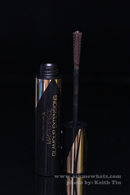 A photo of Max Factor X Masterpiece Glamour Extensions 3-in-1 Volumising Mascara in black brown