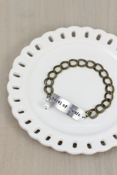 DIY Phantom of the Opera Inspired Stamped Metal Bracelet--An easy, inexpensive gift idea!  pitterandglink.com