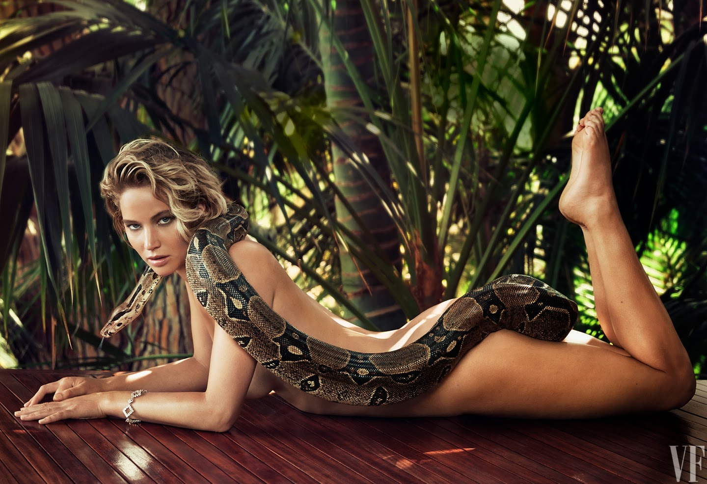 Jennifer Lawrence bravely bares it all with a boa constrictor for Vanity Fair's March 2015 edition