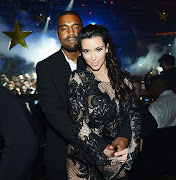 The Kimye show is in full effectKanye West and Kim Kardashian rang in 2013 .