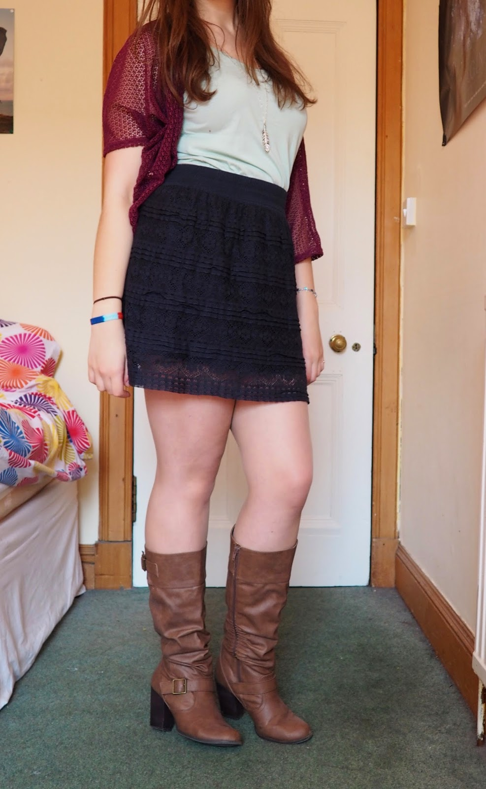 Light Layers outfit | purple-pink knit shrug, green vest, dark blue lace skirt, tall brown leather boots