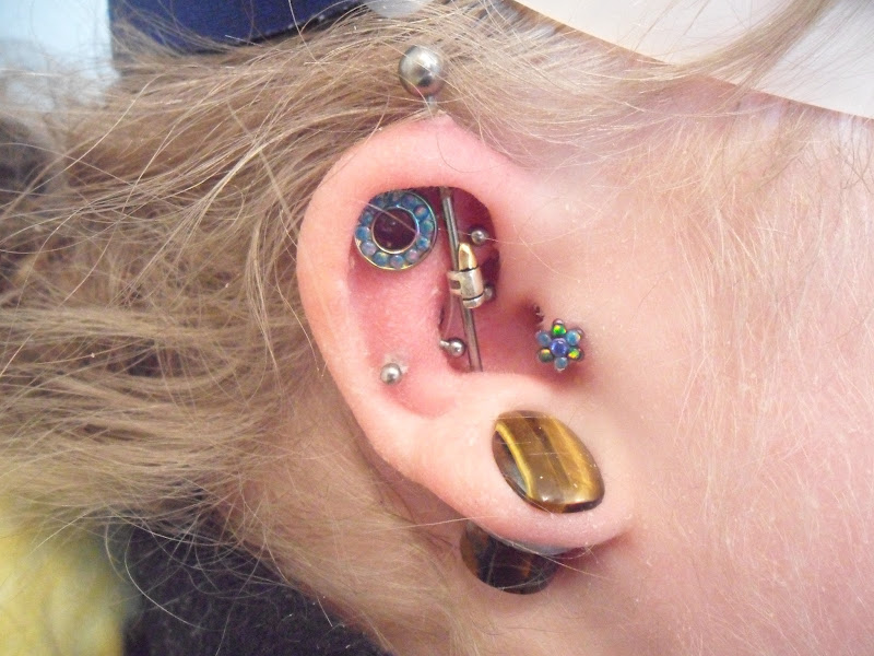 nipple stretch, a tragus change and two surface bars in the wrist  title=