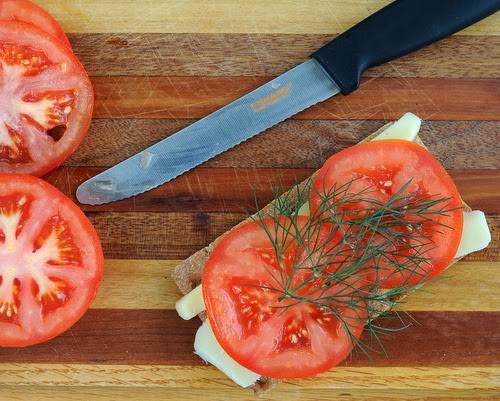 For sharp, clean tomato slices, pick up a tomato knife, a short serrated knive. Another Quick Tip from Kitchen Parade.