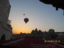 Pre-dawn baloons piercing the sky, Goreme, Cappadocia, Turkey