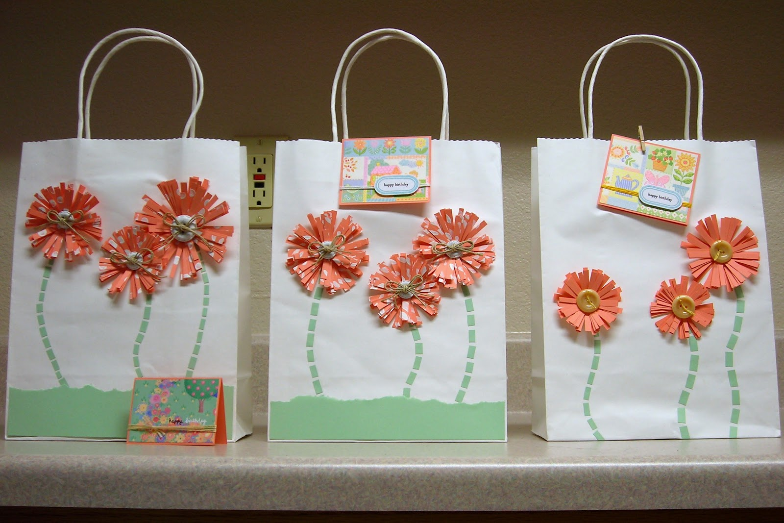 Spare time cardmaking decorating gift bagsrt 2 as i mentioned before these are very inexpensive and the flowers are easy to make i promise instead of using scor tape like it shows in the tutorial i negle Gallery