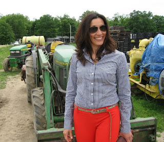 Ana wearing fancy plaid shirt and orange pants...with tractor.