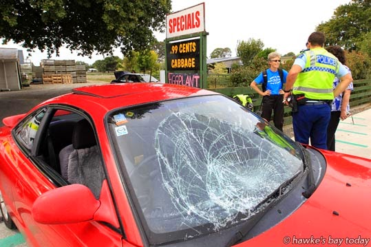 A cyclist on the walkway/cycleway, hit a car pulling out of BayFresh, Havelock Rd, Havelock North, smashing the car's windscreen. Police, fire service, St John Ambulance attended. photograph