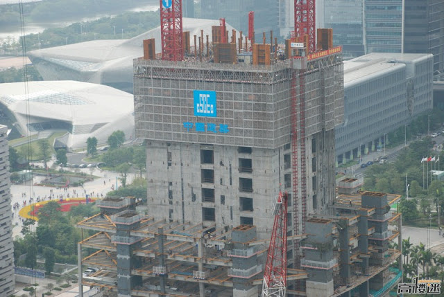 Photo of cranes erecting steel construction for the central core of The Chow Tai Fook Skyscraper, Guangzhou, China
