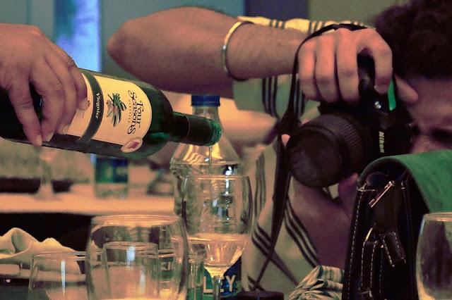 poruing white wine