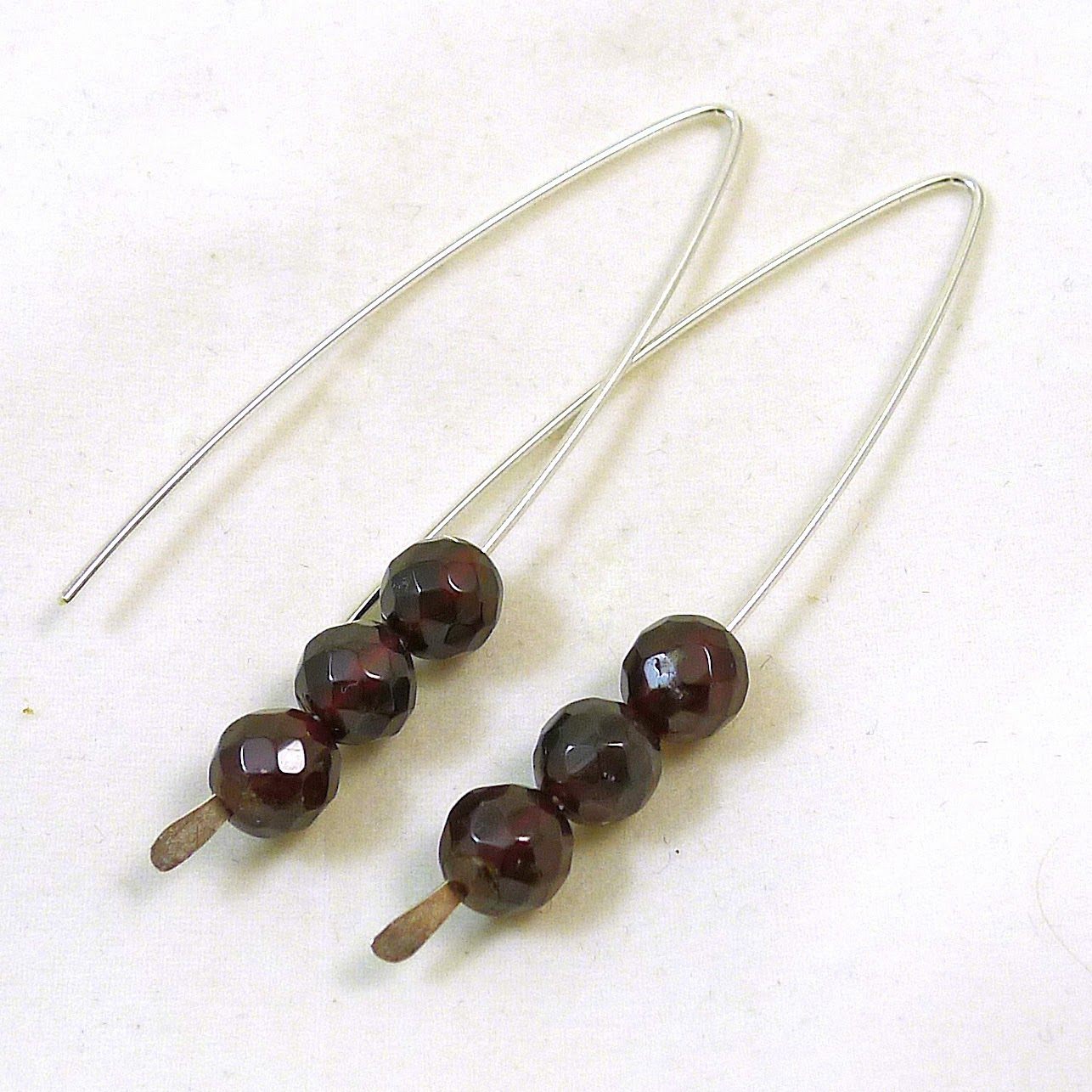 https://www.etsy.com/nz/listing/177091880/garnet-v-style-earrings?ref=shop_home_active_9