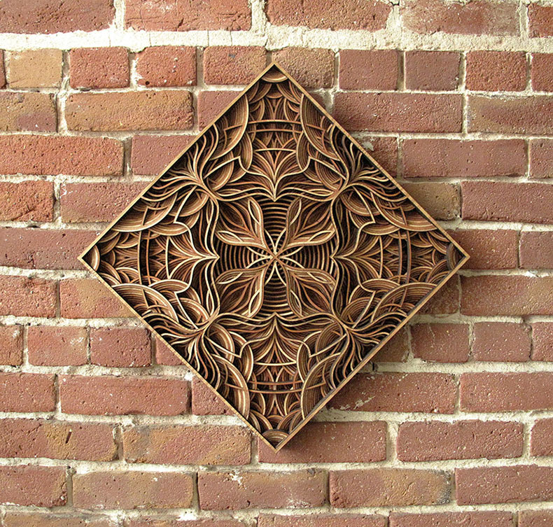 Esculturas en relieves de madera cortadas geométricamente con láser de Gabriel Schama