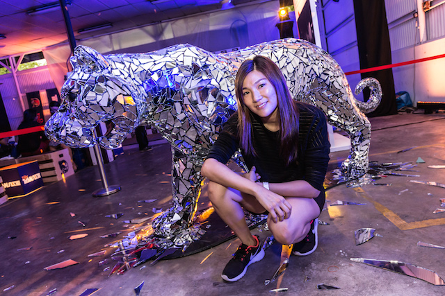 Local artist Louise Low with the shattered-glass and mirror tiger she designed for Tiger Translate.