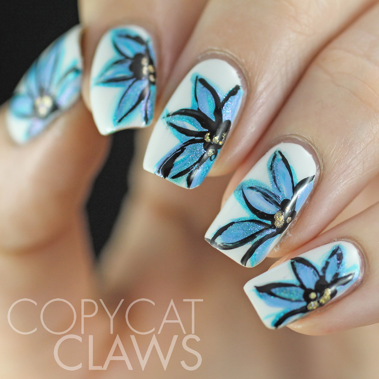Copycat Claws Blue Color Block Nail Art: Copycat Claws: Freehand Blue Flower Nail Art