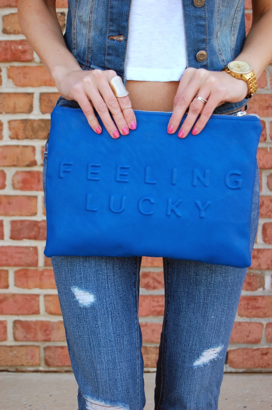 sara feeling lucky leather pouch, denim vest