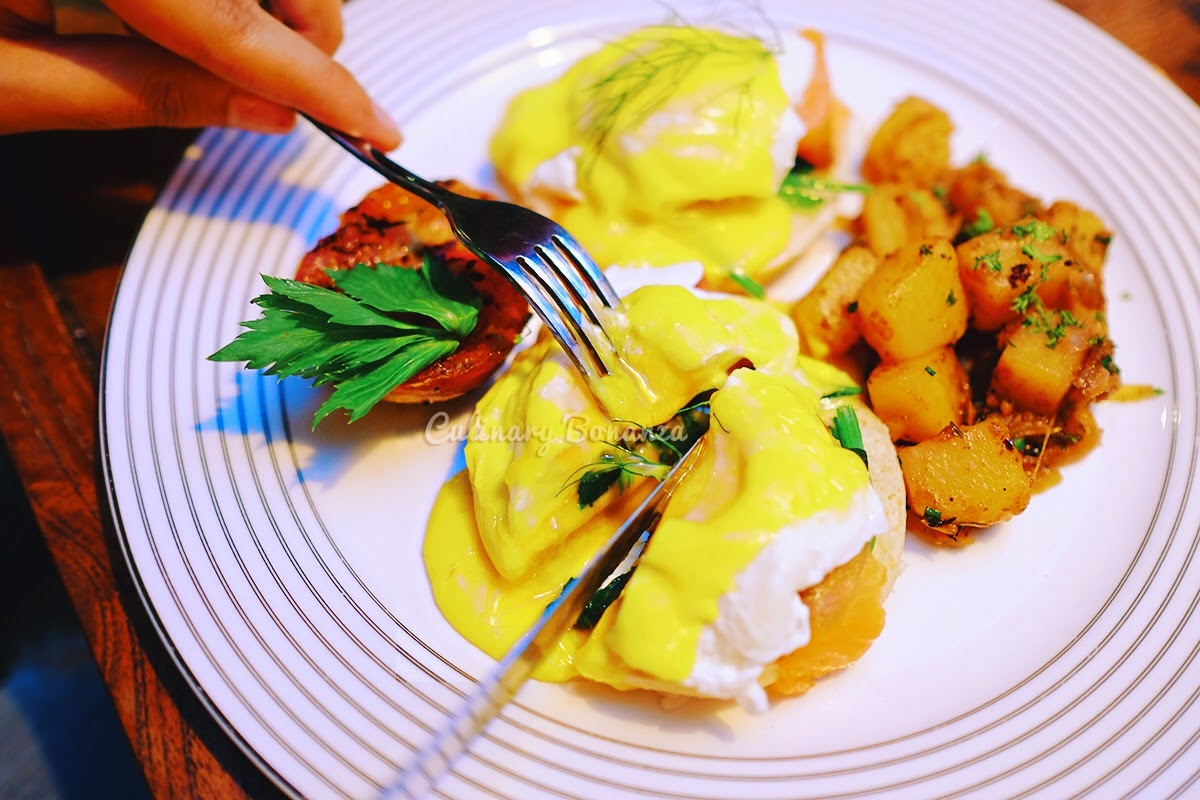 Norwegian Eggs Benedict - poached eggs served on toasted English muffin, layered with Norwegian Smoked Salmon, topped with Hollandaise sauce, served with breakfast potatoes