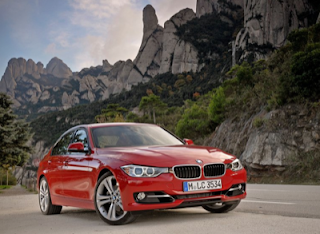 2012 BMW 3-Series red front three quarter