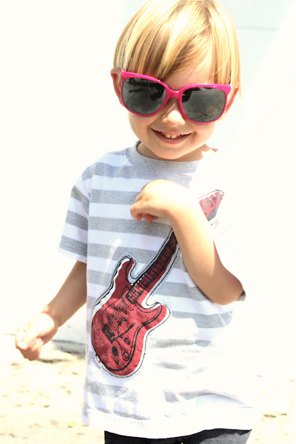 pink sunglasses and guitar t-shirt