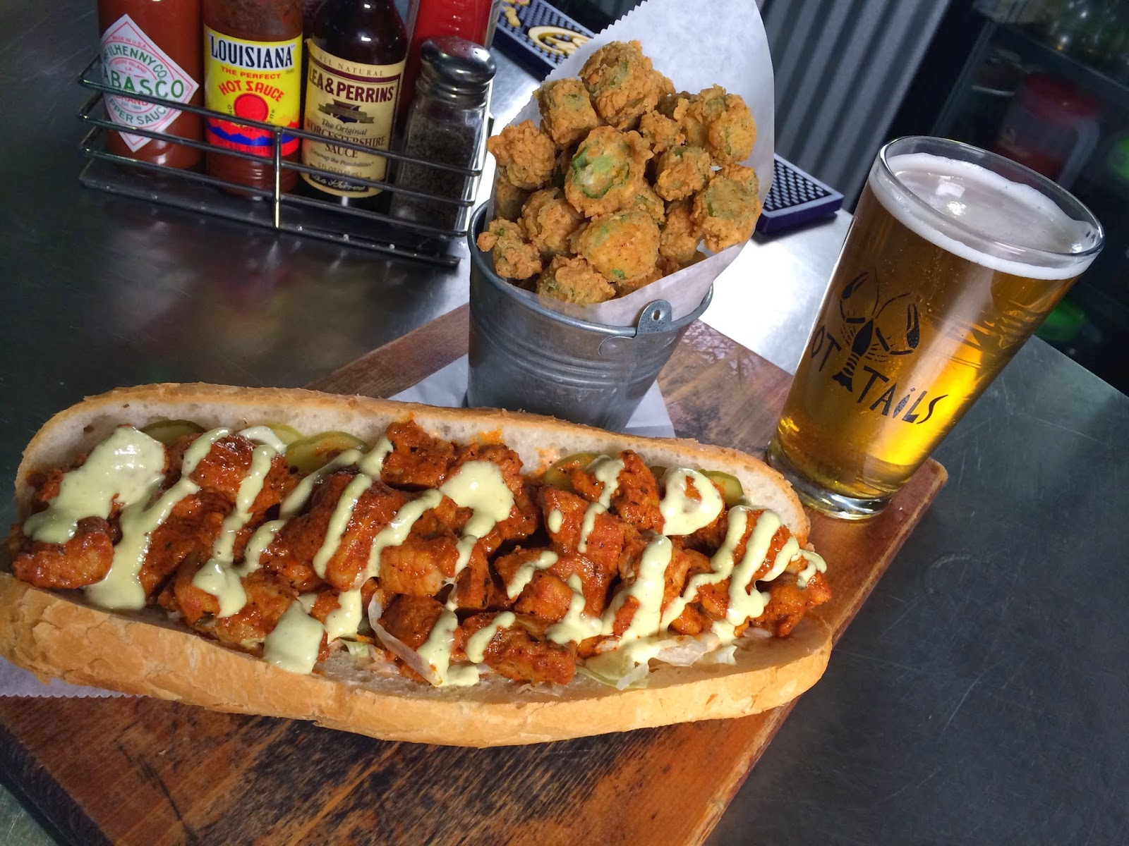Blackened Alligator Po-Boy with Fried Okra and a pint of Tin Roof Blonde