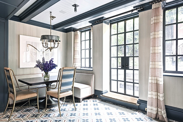 Blue and grey dining room with tile floor in Steven Gambrel's home