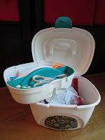 plastic sewing box with tray removed to show storage space