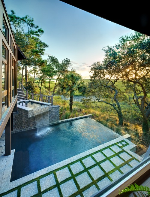 Outdoor pool with small waterfall at Tree House by Anderson Studio Of Architecture And Design