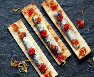 Sardines marinades amb cítrics i melmelada de tomàquet Can Bech