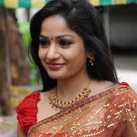 Gorgeous desi diva Madhavi latha hot photos in red transparent saree