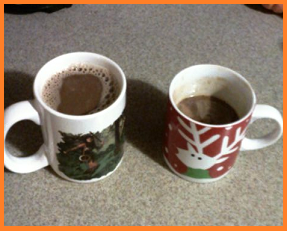 2 mugs of hot chocolate, one only half full.
