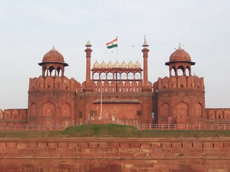 Picture of the front of Red Fort, Delhi, with the Indian flag.