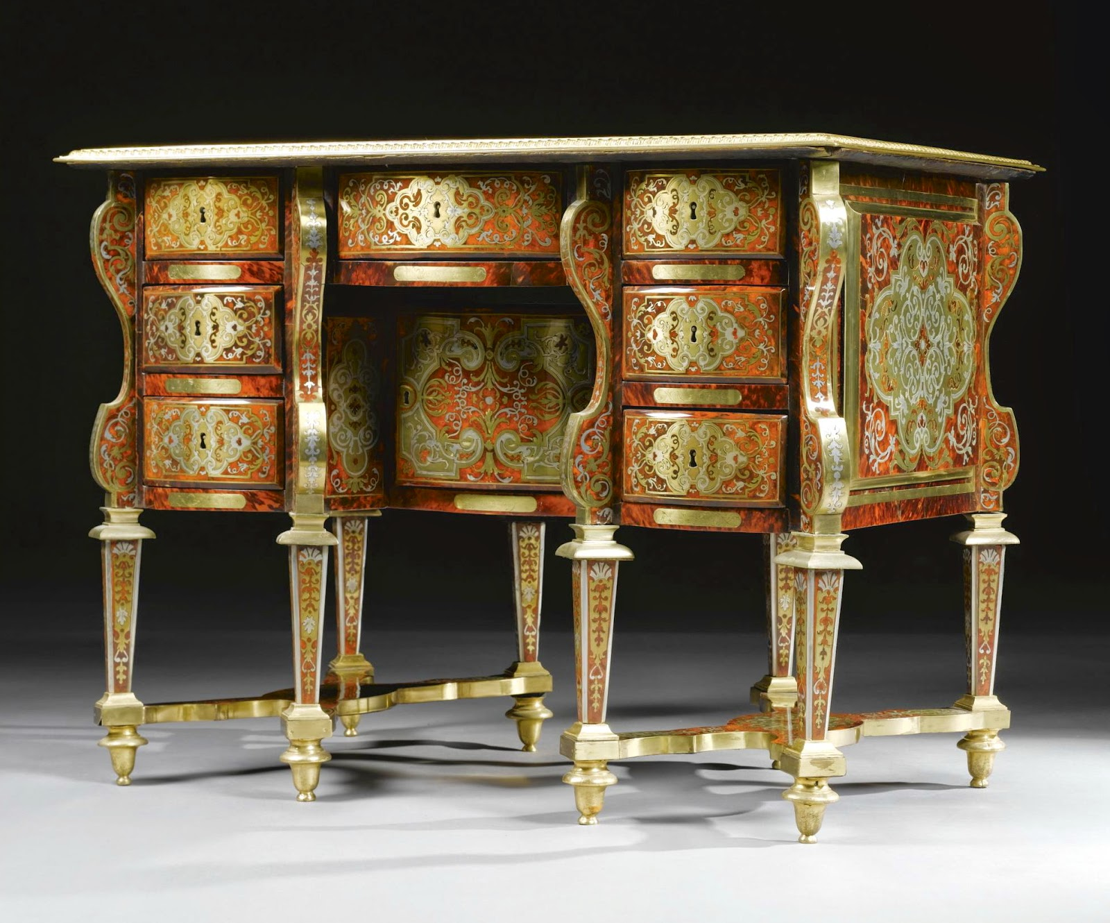 A BRASS AND PEWTER INLAID TURTLESHELL PREMIÈRE-PARTIE BOULLE MARQUETRY BUREAU MAZARIN IN THE MANNER OF ALEXANDRE-JEAN OPPENORDT,LOUIS XIV, CIRCA 1700, Sotheby's