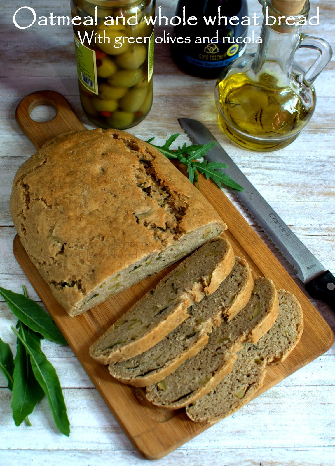 Baking breads : oatmeal and whole wheat bread with green olives and rucola