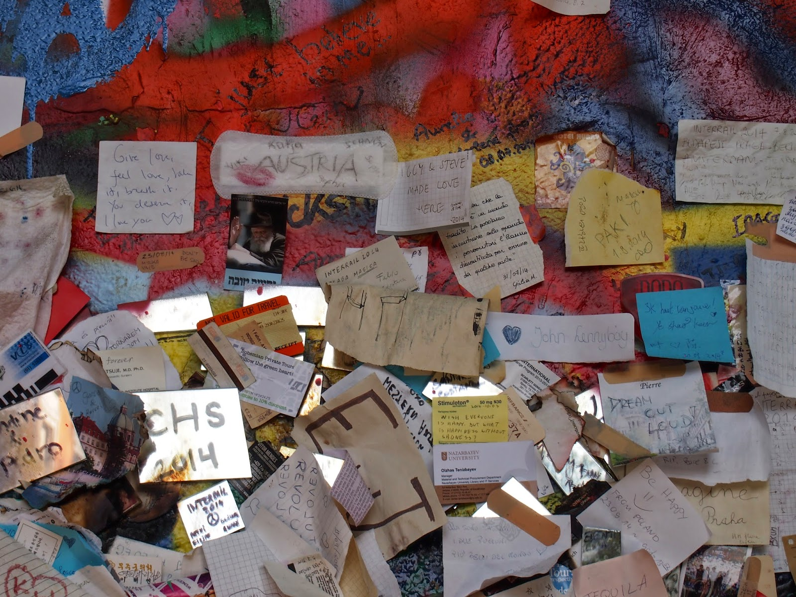 Notes written on paper at the Lennon Wall in Prague
