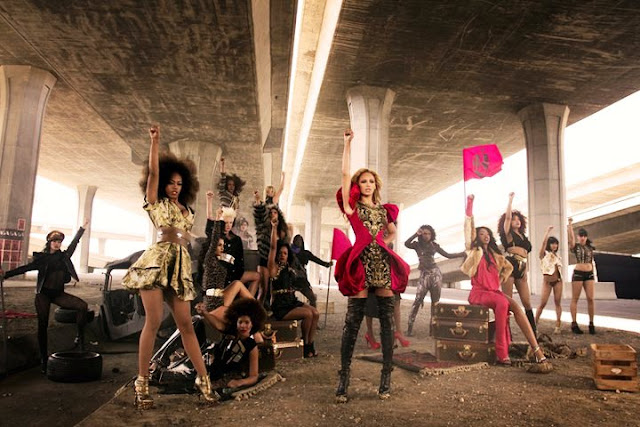 Fashionista and singer Beyonce glamorous style outfits red peplum jacket look from video clip run the world.