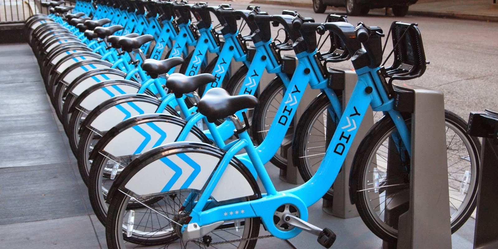 Blue Rental Bikes In Chicago blacks riding bicycles