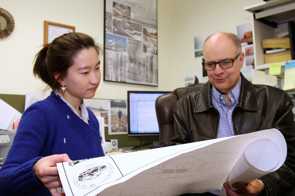 Sung Kim, a UAA senior majoring in construction management, and UAA CM Professor Donn Ketner review architectural floor plans. Reading drawings is a skill taught in the CM curriculum. (Photo UAA Community & Technical College)