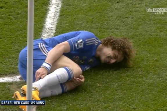 Chelsea player David Luiz is seen to be laughing as he lies on the ground