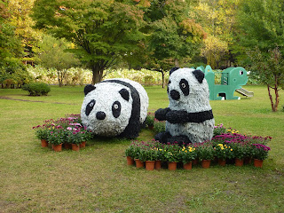 Black and white panda's made of non plant material at Hirosaki Botanical Gardens