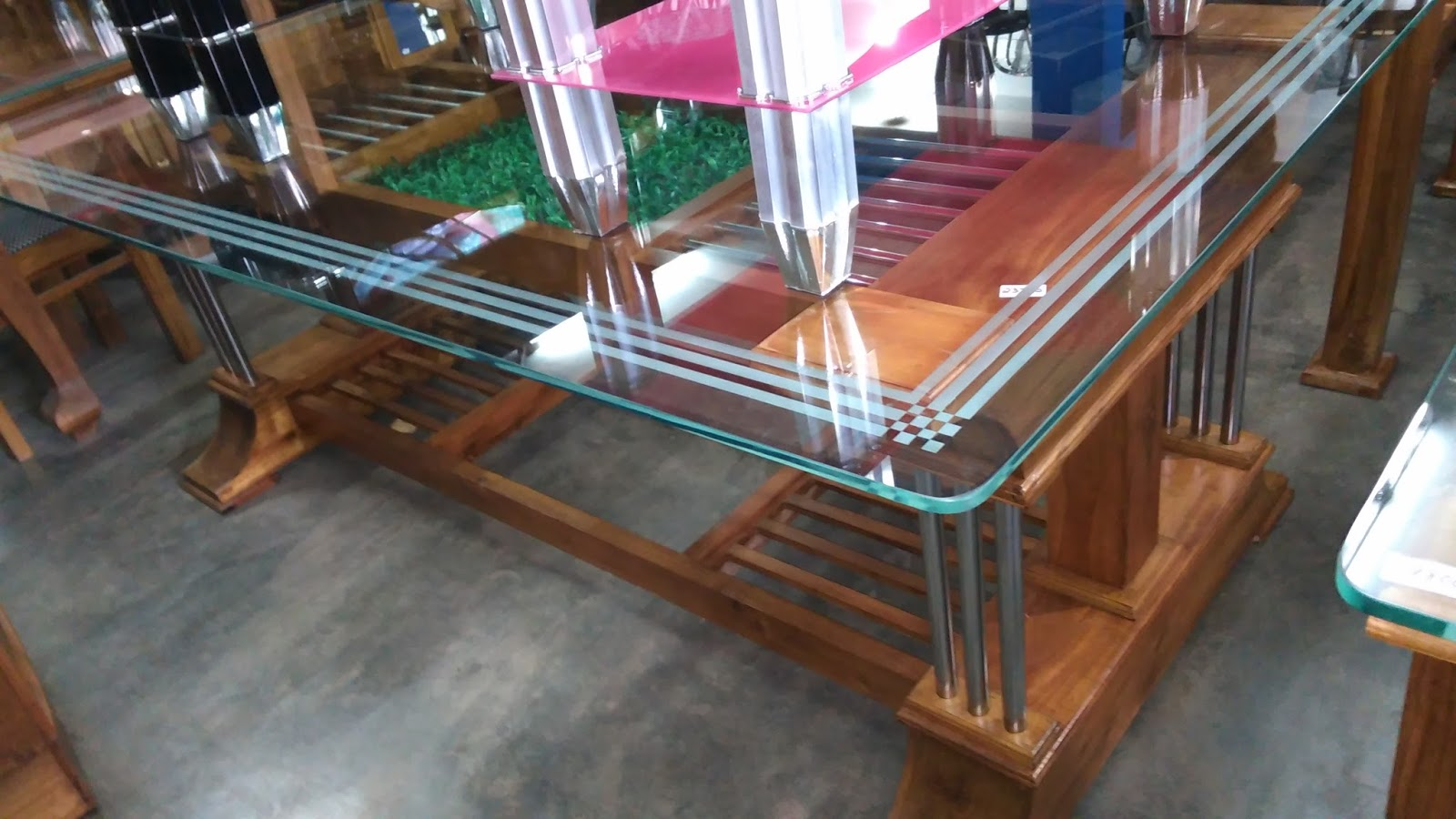 Kerala style carpenter works and designs dining table designs for Wooden glass dining table designs