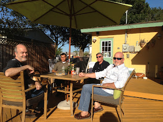 The boys: Fred, Dave, Jerry and Ed sunning themselves on the patio outside.