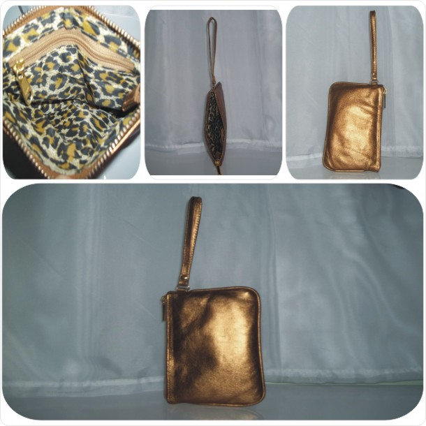 Bolsinha de mão em couro liso: Cód.1001
