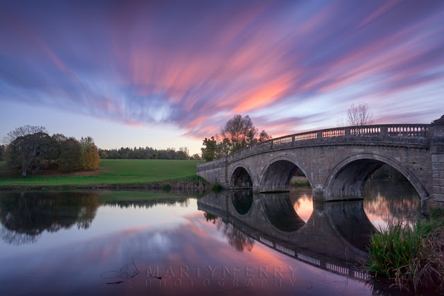 River Glyme at Blenheim Park reflect the sunset colours and the moving clouds by Martyn Ferry Photography