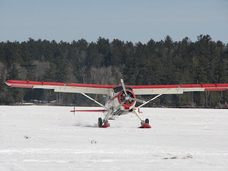 de Havilland Beaver on skis landing in Ely MN on Shagawa lake