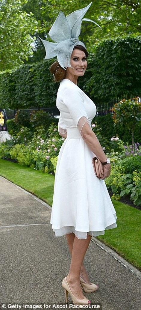 elegant lady in a full skirted dress with a sculptural hat on day 2 at Royal Ascot 2014